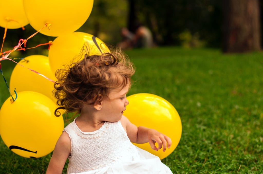First Birthday Gift Ideas- baby playing with balloons