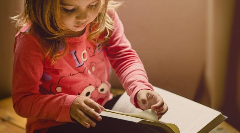 Child reading great moral stories for kids